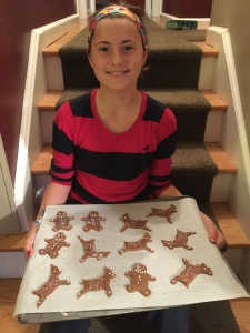 Decorating gingerbread cookies is a fun activity for the kids